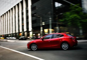 2014_Mazda3_5DR-HB_Red_78DS_Rear_Road_11